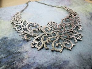 silver metal bib statement necklace