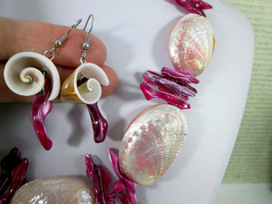 closeup view of pink seashell necklace and earrings set