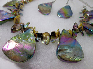 closeup view of rainbow bronze seashell and pearl necklace and earrings set