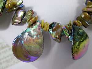 closeup front view of rainbow bronze seashell and pearl necklace and earrings set