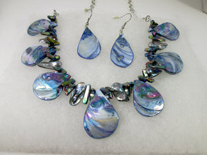 front view of rainbow blue seashell and pearl necklace and earrings set