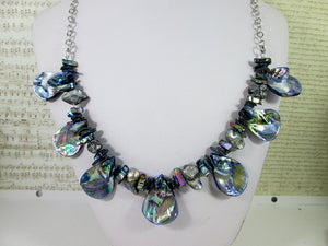 back view of rainbow blue seashell and pearl necklace