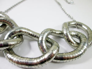 closeup view of  five circles interlocking necklace