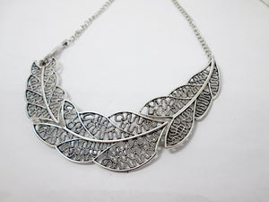 silver filigree leaf sideways necklace