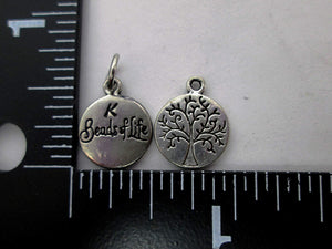 small tree of life charm (front and back view)