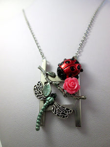 ladder necklace with garden charms