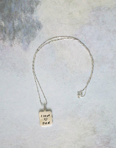 hand stamped message I love dad necklace