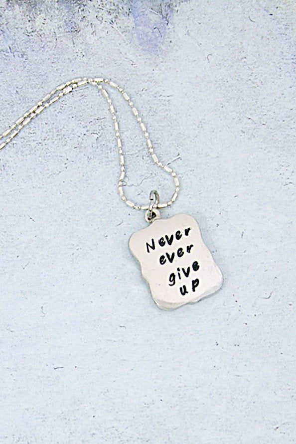 never ever give up necklace