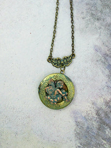 cherub locket necklace
