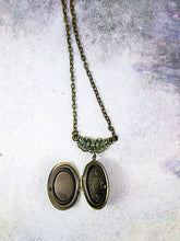 Load image into Gallery viewer, inside view of small oval locket