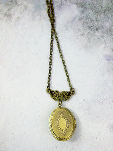 back view of small oval locket