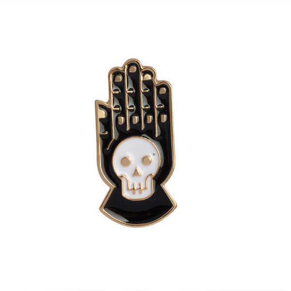 Skull in Hand Enamel Pin