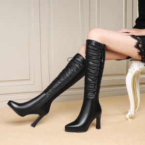Pile of boots high top knight boots leather stiletto