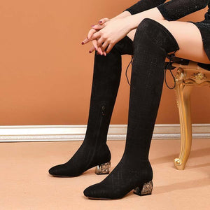Stretch boots with a medium heel and a thick heel over the knee boots