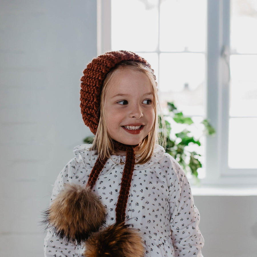 Terracotta Hand-knitted double pompon hat - orkids boutique