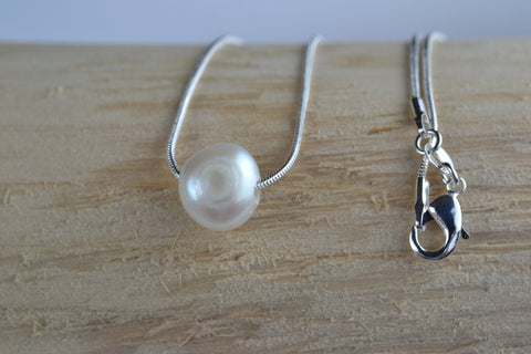 Pendant: Floating ivory pearl on silver snake chain - classic collection - Precious as a Pearl