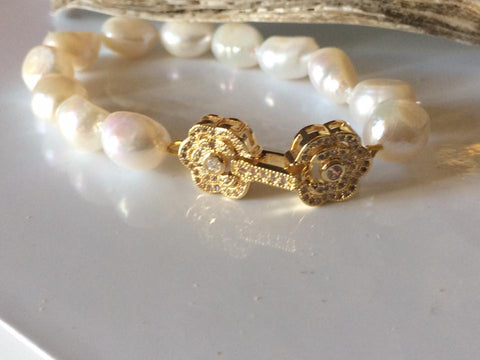 Bracelet: baroque ivory pearl with pretty gold finish flower clasp - classic gold tone - Precious as a Pearl