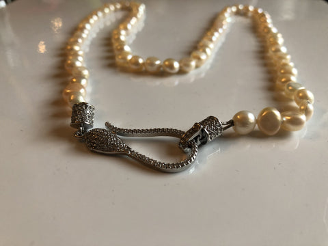 Necklace: peach ivory potato pearl necklace with snake clasp classic