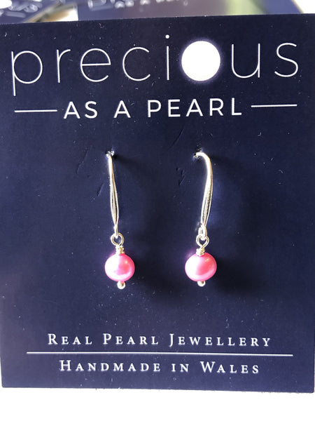 Single pink pearl drop earrings