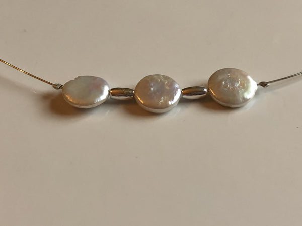 Pearl coin ivory necklace on silver wire with silver highlight beads