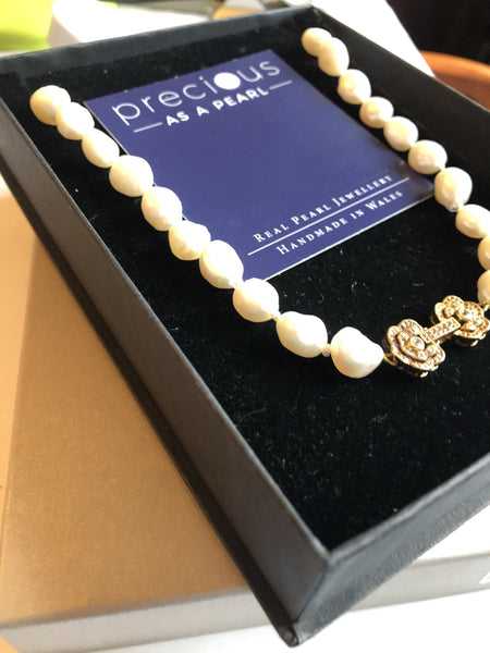 Large baroque ivory pearl necklace with a goldtone flower clasp classic