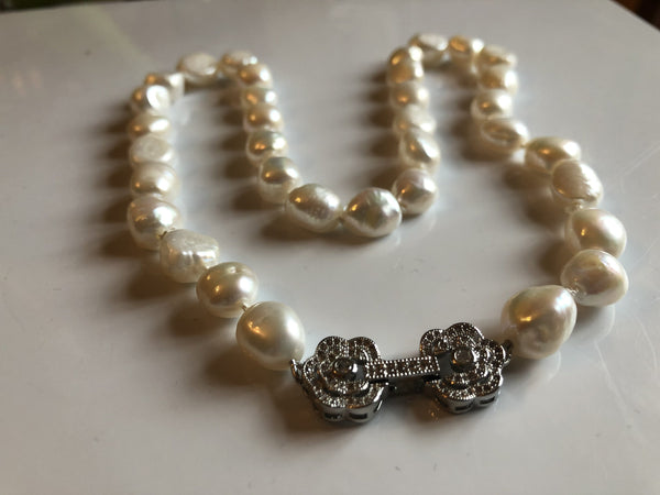 Large baroque ivory pearl necklace with a silvertone flower clasp classic
