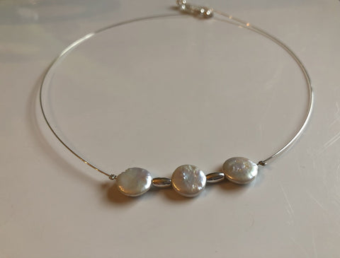 Necklace: Pearl coin ivory necklace on silver wire with silver highlight beads