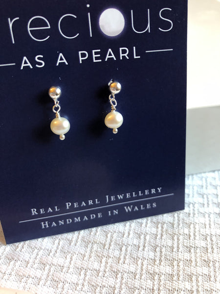 Earrings: Single ivory pearl drop earrings classic