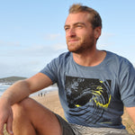 'Last Light' - Denim blue organic cotton surf t-shirt – Modelled by local surfer JB at Fistral beach in Newquay, Cornwall.