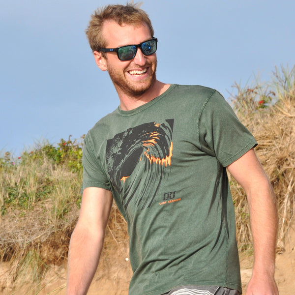 'Last Light' - Stonewashed green organic cotton surf t-shirt – Modelled by local surfer JB at Fistral beach in Newquay, Cornwall.