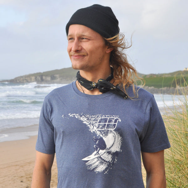 'Carve' - Denim blue organic cotton surf t-shirt – Modelled by local surfer René at Fistral beach in Newquay, Cornwall.