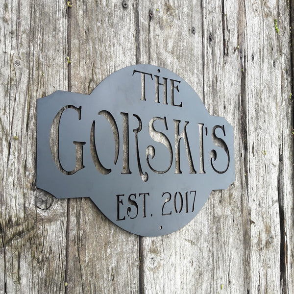 "Rustic metal sign outdoor black powder coated. The sign reads, "" The Gorski's est. 2017"""