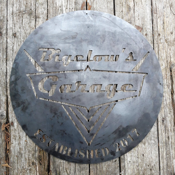 "This is a rustic round metal garage sign which reads, ""Bigelow's Garage, Established 2017"""