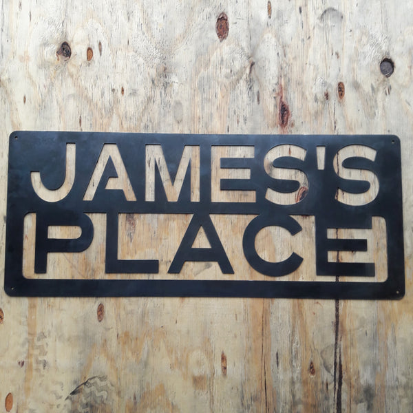 "This is a custom metal sign that reads, ""James's Place""."
