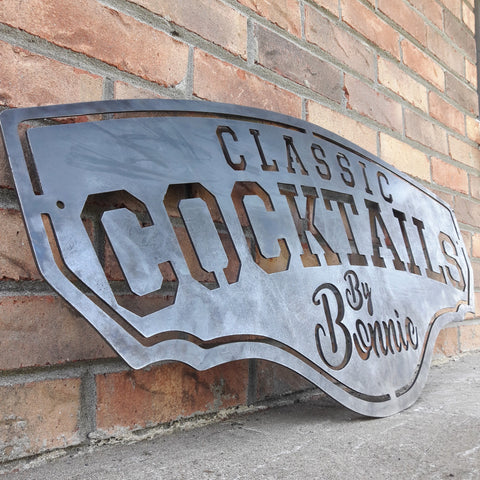 "This metal bar sign reads, "" Classic Cocktails By Bonnie"""