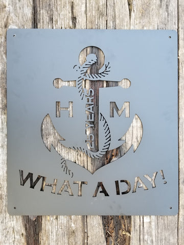 "This personalized metal sign showcases an anchor. On the sign there is initials, the anniversary year count, and a wrap of text. The sign reads, ""What A Day!"""