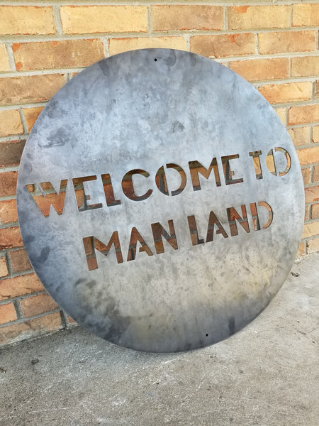 "Round Personalized metal sign that reads, ""Welcome To Man Land""."