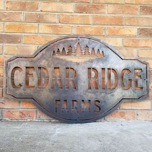 "This is a rustic metal sign showcasing an image of trees at the top. The sign reads, ""Cedar Ridge Farms""."