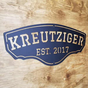 "This personalized metal sign reads, ""KREUTZIGER Est. 2017""."