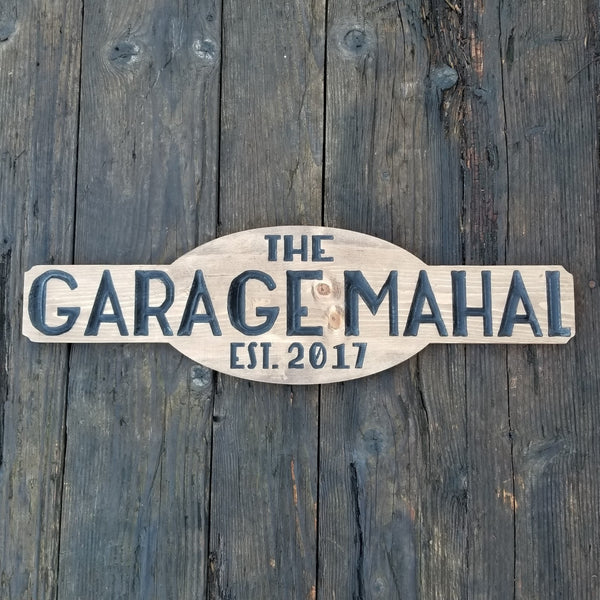 "Walnut Stained wood sign with black painted letters that reads, ""The Garage Mahal Est. 2017"""