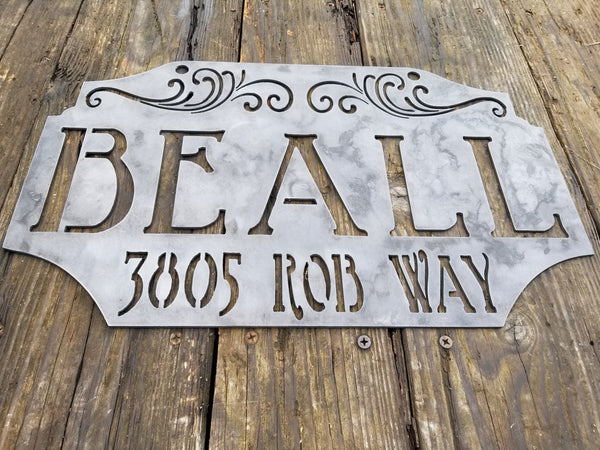 "This custom metal address sign is raw steel and reads, ""Beall 385 Rob Way"""
