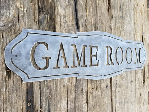 "This home decor metal sign reads, ""Game Room"""