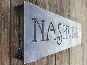 "This is a 18"" rectangular sign  with 1"" stand-offs that reads, ""NASHVILLE"""