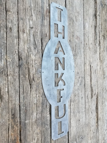 "This custom vertical  metal sign reads, ""Thankful""."