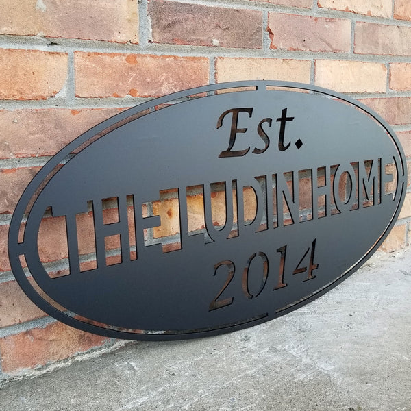 "This classic Name and date sign powder coated black and reads, "" The Ludin Home Est. 2014"""