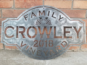 "This custom metal sign has a cluster of grapes and reads, ""Crowley Family Vineyard, 2018"""
