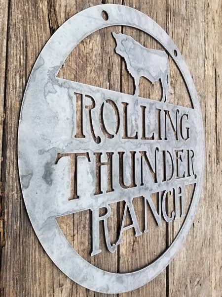 "This is a custom round metal sign that features a steer and reads from the top down, ""Rolling Thunder Ranch"""