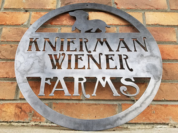 "This is a custom round metal sign that features a wiener dog and reads from the top down, ""Knierman Wiener Farms"""
