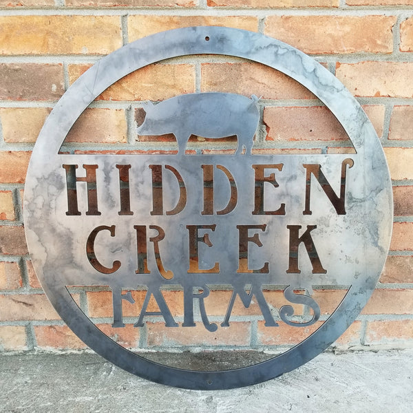 "This is a custom round metal sign that features a Pig and reads from the top down, ""Hidden Creek Farms"""