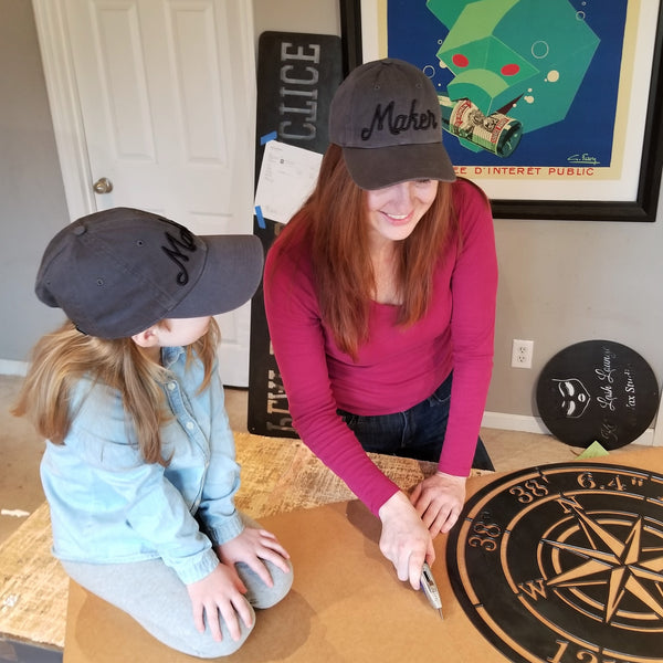 This is an image of one of the owners, Stefanie Heffner, with her daughter preparing a sign for shipment.